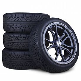 picture of four-wheel  - Closeup of four tires with racing rim and black texture isolated over white background - JPG