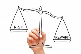 picture of risk  - Hand drawing Risk Reward scale concept with black marker on transparent wipe board isolated on white - JPG