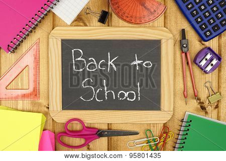 Back To School chalkboard with school supplies