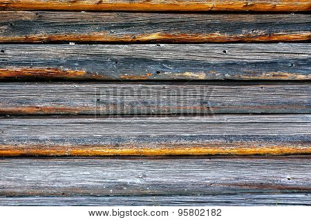 Part Of The Wall Made Of Wooden Logs