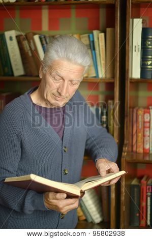 Elderly happy man with book