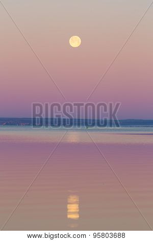 Moon Setting Over Sea.