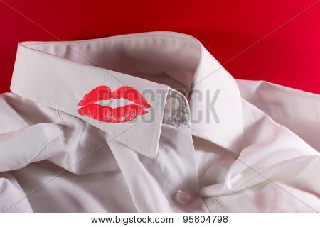White Used Man's Shirt And Red Lipstick