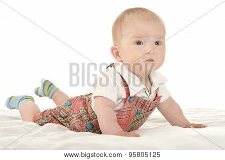 Baby boy crawling on blanket