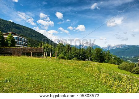 OBERSALZBERG, GERMANY - JUNE 22: Kempinski Berchtesgaden Hotel, a 5 Star Luxury Hotel High in Alps Location, Overlooking Obersalzberg, Germany with Views of Mountains on Sunny Day on June 22, 2015