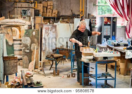 BARCELONA, SPAIN - MAY 03: Glass maker on his workplace in Poble Espanyol, Barcelona, Spain on May 03, 2015