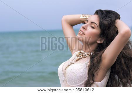 Beautiful Young Brunette Woman Outdoors Portrait Near The Sea