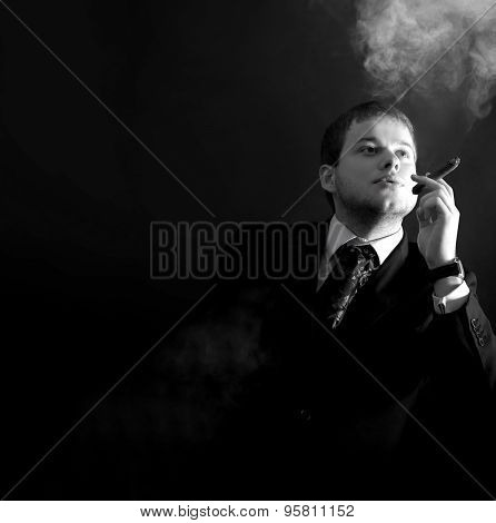 Man in a suit smoking  cigar