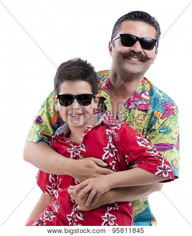 Portrait of happy father and son of eleven years old wearing eyeglasses isolated on white background