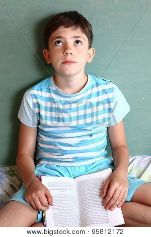 preteens handsome boy with book tired closed hes eyes