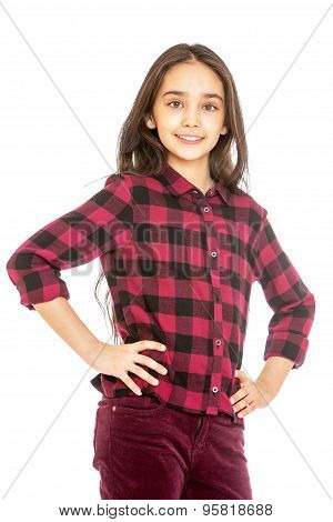 Charming long-haired girl in a plaid shirt and corduroy jeans , close-up