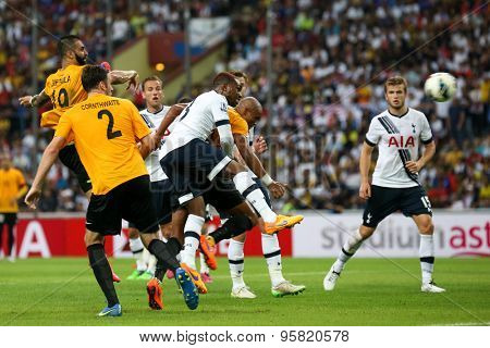 May 27, 2015 - Shah Alam, Malaysia: Malaysian strikers (orange jersey) attempt a strike at goal in a match against Tottenham Hotspur (white jersey). Tottenham Hotspur is on a Asia-Australia tour.