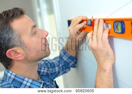 Builder making sure a wall is straight