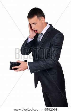 Business Man Looking At His Empty Wallet