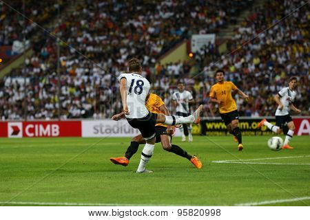 May 27, 2015- Shah Alam, Malaysia: Tottenham Hotspur's striker Harry Kane (18) kicks the ball in the friendly match against the Malaysian Selection Team. Tottenham Hotspur is on a Asia-Australia tour.