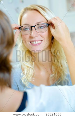 Fitting spectacles on a lady