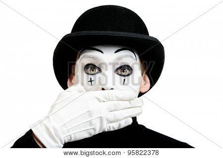 Close-up portrait of a male mime artist showing secret, silence. Isolated over white.