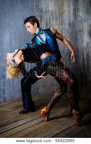 Two beautiful dancers perform the tango. Latin American dances.