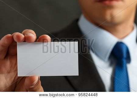 Businessman In Suit And Hand Holding Blank Calling Card
