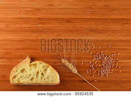 Cutting Board With Wheat Ear, Grains And Slice Of Bread