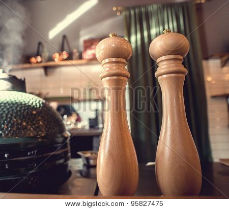 Salt and pepper shakers on the table