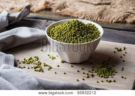 Mung Bean in white bowl over wooden background