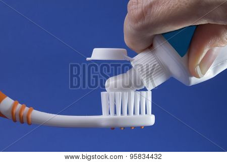 serving tooth paste to brush