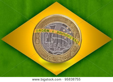 One Brazilian Real flag with a one real coin inside