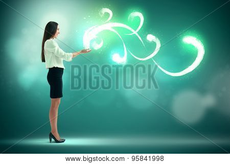 smiley pretty woman holding in her palms beautiful glow over green background