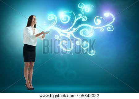 amazed woman looking at beautiful glow on her palms over blue background