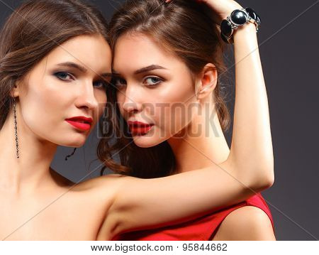Two young beauty women standing together .