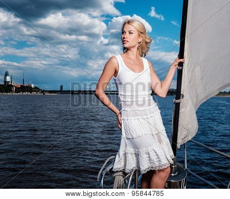 Stylish wealthy woman on a luxury yacht