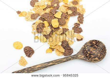 Cereal And Wooden Spoon On White Background