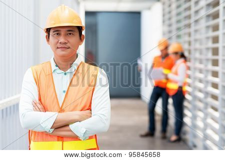 Middle-aged Asian contractor