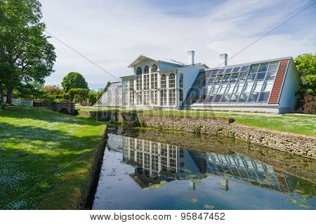 Orangery Of Palmse Manor And Reflection In Water Canal, Estonia