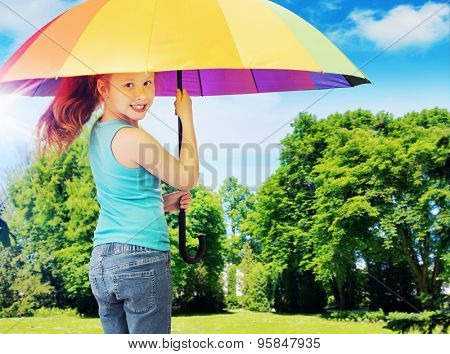 Happy little girl with an colorful umbrella