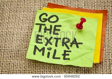 go the extra mile  - motivational reminder - handwriting on sticky note