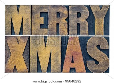 Merry Xmas (Christmas) greetings or wishes - isolated text in vintage grunge letterpress wood type blocks
