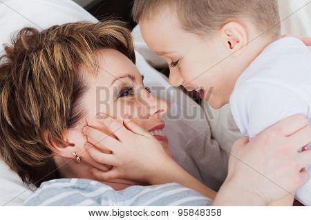 Happy child holding her mom