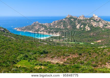 Corsica, Landscape With Mountains And Beach
