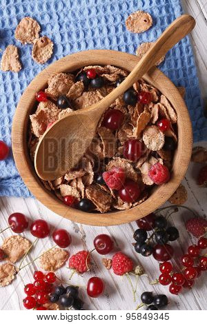 Muesli With Fresh Berries Close Up In A Wooden Bowl. Vertical Top View
