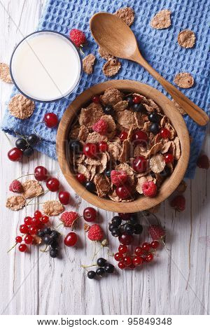 Muesli With Fresh Berries And Milk On The Table. Vertical Top View
