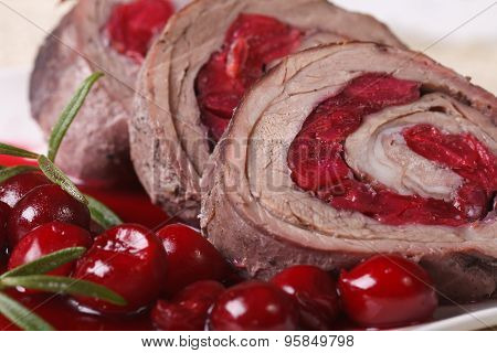 Meat Roll With Cherries Macro On A Plate. Horizontal
