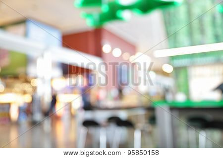 Duty free shops and cafes in airport hall - blured background out of focus