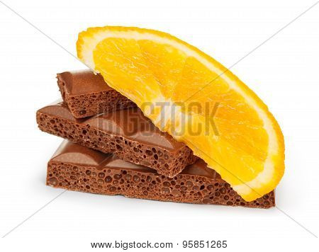 Roughly Cut Chunks Of A Chocolate Bar With Orange Fruit