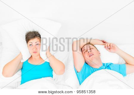 Woman Can Not Sleep From Snoring Husband, The Pillow Covering Her Ears