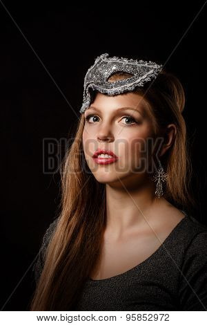 Teen Girl With An Evening Make-up And Masquerade Mask.