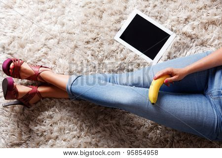 A Banana In A Woman's Hand