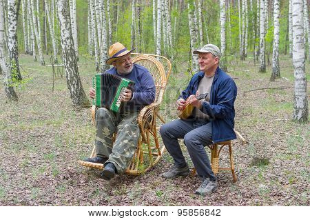 Two seniors playing music