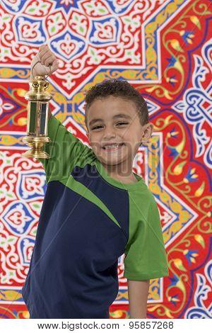 Smiling Young Boy With Ramadan Lantern